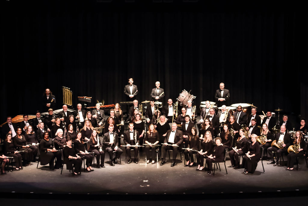 photo of Carolinas Wind Orchestra before a performance